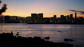 Scape de la ciudad de Tokio a la hora de igualar puesta del sol con la silueta o fotos de archivo libres de regalías