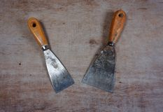 Scaper tools metal spatula on a wooden background royalty free stock photography