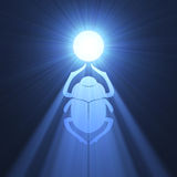 Scarab beetle Egyptian symbol light flare. Scarab (Scarabaeidae, Dung beetle) in ancient Egypt as sign of sun god with powerful blue light halo. Extended flares Royalty Free Stock Photos