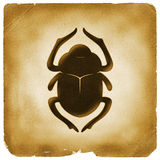 Scarab beetle Egyptian symbol old paper Royalty Free Stock Image