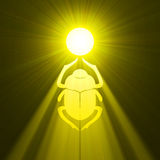 Scarab beetle Egyptian symbol sun flare. Scarab (Scarabaeidae, Dung beetle) in ancient Egypt as sign of sun god with powerful light halo. Extended flares for Royalty Free Stock Image