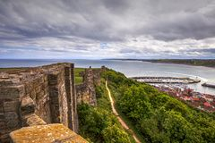 Scarborough Castle in North Yorkshire. Medieval ruin of Scarborough Castle in North Yorkshire, view from walls stock photo