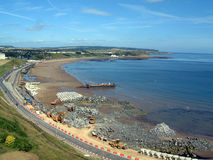 Scarborough Coastal Erosion. A general view of Scarborough Castle in Scarborough in England. This is pictured from the North Bay, and in the foreground you can Stock Image