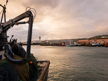 Scarborough fishing docks, with trawler in foreground. Royalty Free Stock Photography