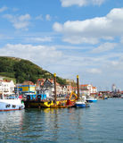 Scarborough Harbour. Bustling Ancient Scarborough Harbour and Castle Royalty Free Stock Photography