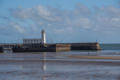 Scarborough Harbour and lighthouse on the seafront stock photos