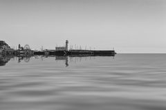 Scarborough Lighthouse. Black and White Image of Scarborough Lighthouse with Reflection, England Royalty Free Stock Photography