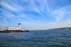 Scarborough lighthouse viewed from the harbour Stock Photo