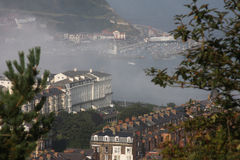 Scarborough in summer mist or sea fret. Royalty Free Stock Photography