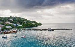 Scarborough - Tobago island - Caribbean sea. Republic of Trinidad and Tobago - Sunrise on Tobago island - Scarborough - The harbor - Caribbean sea stock image