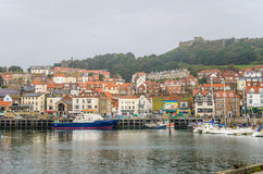 Scarborough Town Centre viewed from the Harbour on Misty Autumn Day Royalty Free Stock Photo