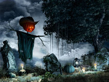 Scarecow among tombstones Stock Images