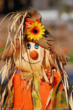 Scarecrow. A smiling scarecrow welcomes autumn on a sunny fall day Stock Photo