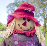 Scarecrow. Happy Scarecrow welcomes the Autumn in Stock Image