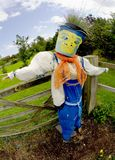 Scarecrow. In old clothes warning off birds in organic garden Royalty Free Stock Photography