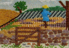 Scarecrow. In the field. handicraft beading Stock Image