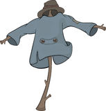 Scarecrow. Dressed in a coat and a hat Royalty Free Stock Images