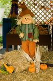 Scarecrow. Fall scarecrow decoration on bale of hay Stock Image