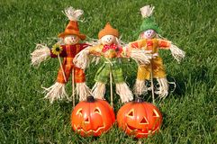 Scarecrow. And pumpkin in garden Royalty Free Stock Images