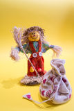 Scarecrow and bag. A funny colorful scarecrow with a bag Stock Image