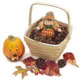 Scarecrow in a basket of pine cones Stock Image
