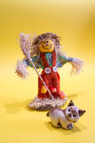Scarecrow and cat. A funny colorful scarecrow with a cat Stock Image