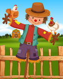 Scarecrow and chickens on the farm Stock Image