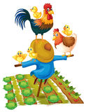 Scarecrow and chickens in vegetable garden Royalty Free Stock Image