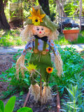 Scarecrow. A cute yet scary scarecrow in a home garden Royalty Free Stock Image
