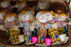 Scarecrow  doll toys basket for sale. Scarecrow doll toys for sale on a big basket Royalty Free Stock Photography