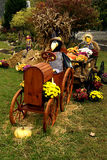 Scarecrow driving tractor fall decorations Stock Images