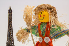 Scarecrow and eifel tower. A funny colorful scarecrow with the eifel tower Stock Photography