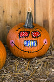 Scarecrow face. Painted on pumpkin Royalty Free Stock Photography