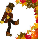 Scarecrow and fall leaves. Scarecrow with hat and pumpkin head framed by  fall leaves Royalty Free Stock Photo