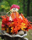 Scarecrow with Fall Leaves Royalty Free Stock Image