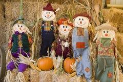 Scarecrow family. Family of scarecrows in autumn setting Stock Photos