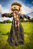 Scarecrow in a field. Full length portrait view of a scarecrow in a field on a sunny summer day Stock Photos