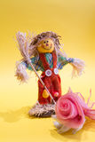 Scarecrow and flower. A funny colorful scarecrow with the flower Stock Photo