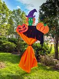 Scarecrow Frankenstein with pumpkins. In a park outside in a sunny day royalty free stock image