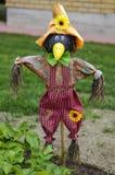 Scarecrow fright. Scarecrow in a kitchen garden, summer at dacha, a kitchen garden, a personal plot Stock Photo