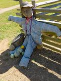 Scarecrow at a Garden Entrance. Waynesboro, VA – October 3rd: A scarecrow at an entrance to a garden located at Humpback Rock Farm Museum located on the Blue Stock Photography