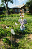 Scarecrow on the garden. Stock Photos