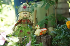 Scarecrow in a garden. Stuffed scarecrow on a traditional fence in northern Sweden stock image