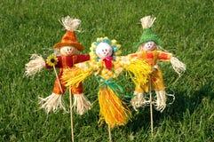 Scarecrow on grass. In garden Stock Photo