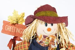 Scarecrow greetings. Isolated shot of scarecrow head with greetings banner royalty free stock photo