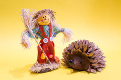 Scarecrow and hedgehog. A funny colorful scarecrow with a hedgehog Royalty Free Stock Images