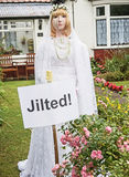 Scarecrow at Hinderwell Festival. Jilted blond bride look-alike wearing white wedding dress and in tears, included as an entry to the Hinderwell scarecrow royalty free stock image
