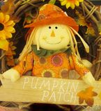 Scarecrow holding sign saying pumpkin patch Stock Images