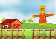 A scarecrow inside the wooden fence. Illustration of a scarecrow inside the wooden fence Stock Photography