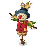Scarecrow made of straw and grass in red clothes Royalty Free Stock Image